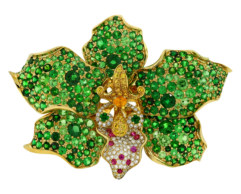 Isis - Orchid brooch/wrist cuff with tsavorite garnet, yellow sapphire, pink sapphire, and diamond by Paula Crevoshay • Photo by Chris Chavez