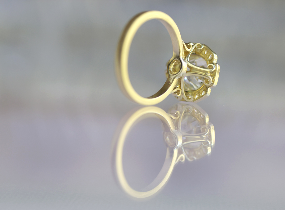 Caroline halo engagement ring in 18k yellow gold